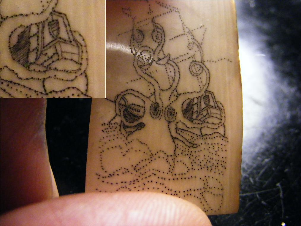 Kraken scrimshaw on mammoth ivory with detail callout to the upper left