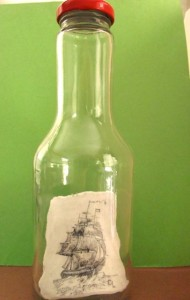 Scrimshaw of a ship in full sail in a bottle