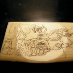 kraken scrimshaw viewed sideways and at a slight angle to show the lines