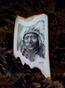 Darrel Morris' Scrimshaw of a Crow Warrior on Mammoth Ivory