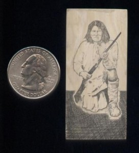 Scot Kimel Scrimshaw of an Apache Warrior kneeling - quarter to the left for scale