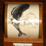 Beautiful breaching sperm whale on mahogany Mystery Artist # 7 on scrimshaw.com
