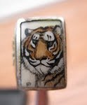 Tiger ring with the initials HM or HN in the lower left hand Corner - Mystery Artist #11