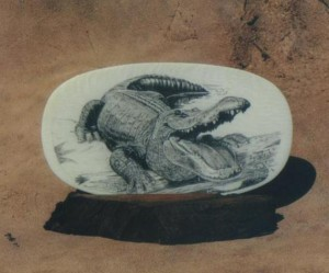 Belle Ochs' scrimshaw of an Alligator with it's mouth open
