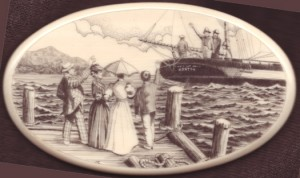 Scrimshawed harbor scene by Michael Cohen with a ship setting sail and people waving from the dock