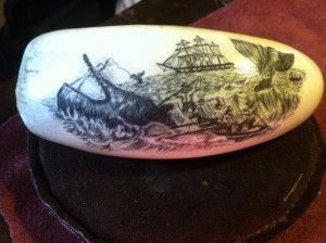 scrimshaw of a whale with a ship in the background