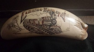 Scrimshaw Train on a sperm whale tooth from the 1970s