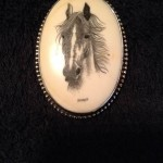 Horse portrait on oval cabochon with the name KNIGHT in block letters