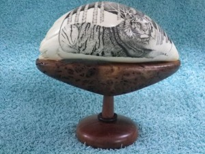 Scrimshaw of a tiger on a wood base by Rod Lacey