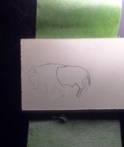 Stippling of the Buffalo in progres on paper micarta.  Hind portion outline stippling completed, front portion not finished.