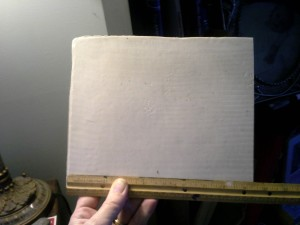 quarter sheet of casein with ruler at the bottom.