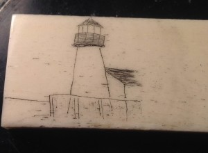Lighthouse scrimmed into bone and stained with India ink