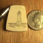 Lighthouse scrimshaw on galalith with a quarter to the right to show the scale