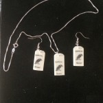 "Necklace and Earrings with raven and the words: ""Quoth the raven, 'Nevermore.'"""