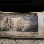 Closeup of two battling ships scrimshawed on one of the tusks from Mystery Artist 23
