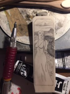 Lady and Dragon scrimshawed into alt. ivory for a letter opener